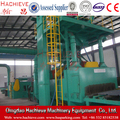 Roller conveyor type wheel blasting machine for steel beam surface cleaning