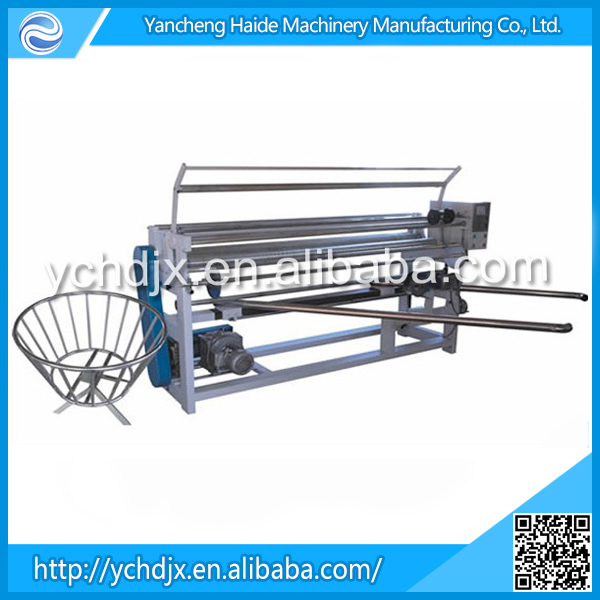 Fabric winding machine with edge aligning