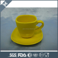 Model design with beautifu yellow color coffee cup and saucer