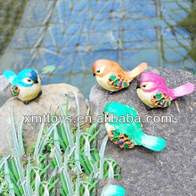 Children toy statue of small colorful bird
