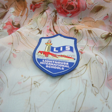 custom rounded woven patch work in blouse neck designs