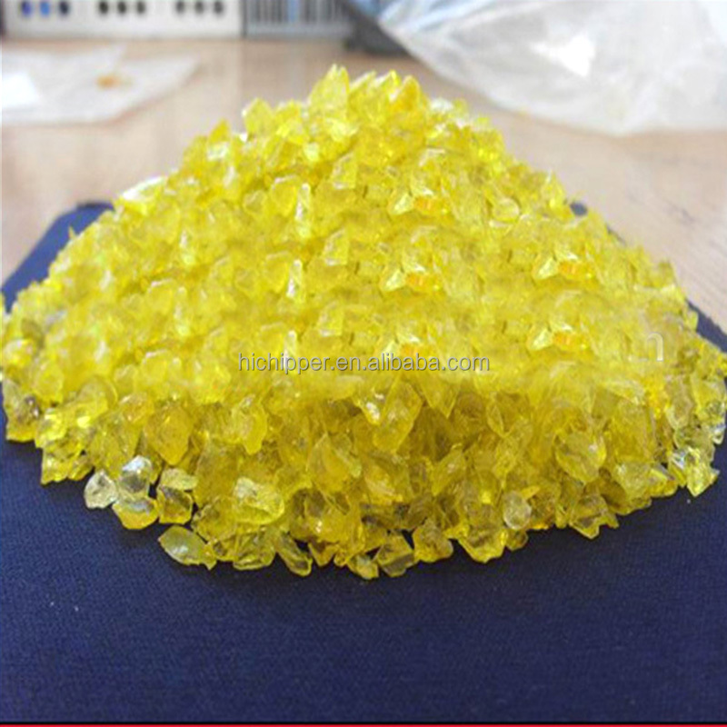 Crushed yellow landscaping glass sand