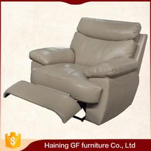 cream leather covering thickly padded headrest electric power recliner