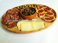Oval wooden trays and ceramic dishes