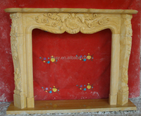 Yellow marble carved simple fireplace