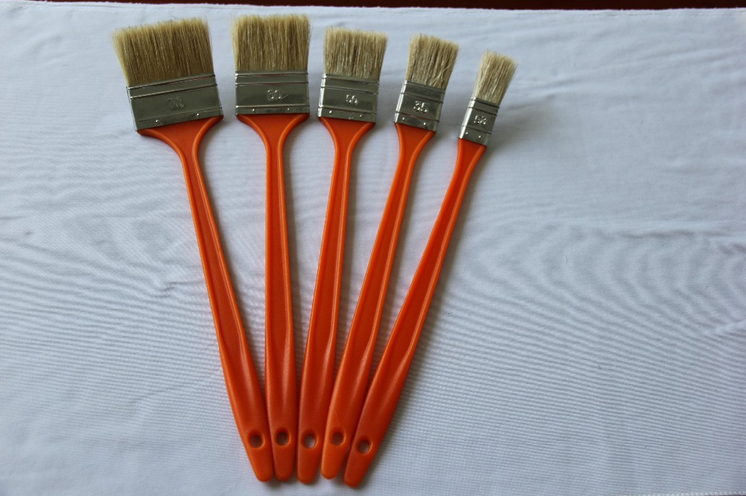 Red plastic handle elbow painting brush