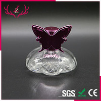 Dubai fancy glass perfume bottle 60ml with UV cap butterfly cap