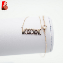 shiny gold stainless steel necklace with words chain
