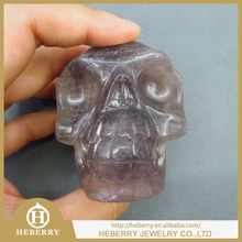 High classic purple fluorite human skull sculpture