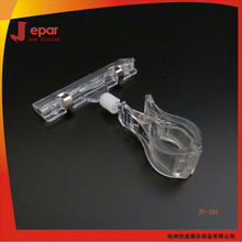Clear plastic poster clip for supermarket shelf information display