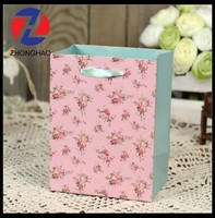 New Arrived decorative handmade ribbon handle dot and flower gift cratf paper bag