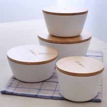 small ceramic rice bowl with wooden cover