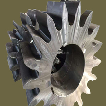 Large metal toothed spur gear applied to the ship