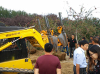 Tree transplanter fixed on wheel loader and pick up truck