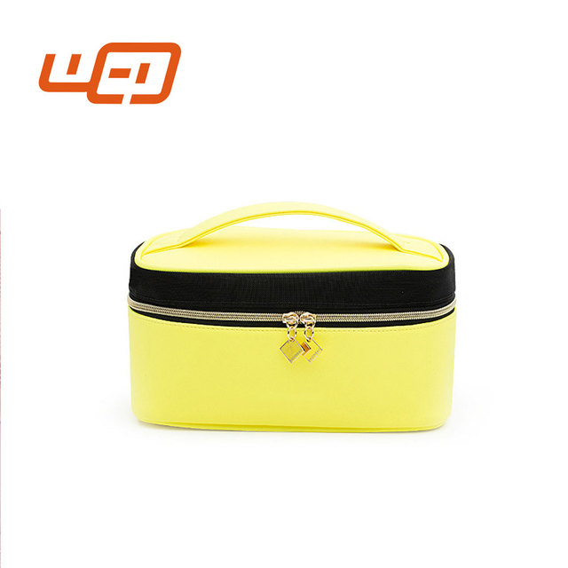Wholesale high quality waterproof yellow large capacity women channel makeup kit box cosmetic organizer bag
