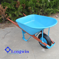 agricultural tools and uses blue wheelbarrow for farm