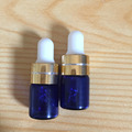 Factory supplies blue 1ml 2ml glass essential oil bottle with dropper