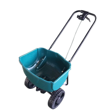 Two-wheeled hand plastic spreader for seed and fertilizer