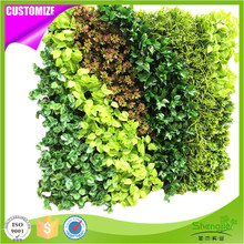 Top quality plastic artificial vertical green foliage wall panel for office decoration