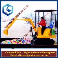 Toy excavator electric with music in amusement park/market