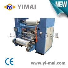 Jumbo roll film slit and rewind machine