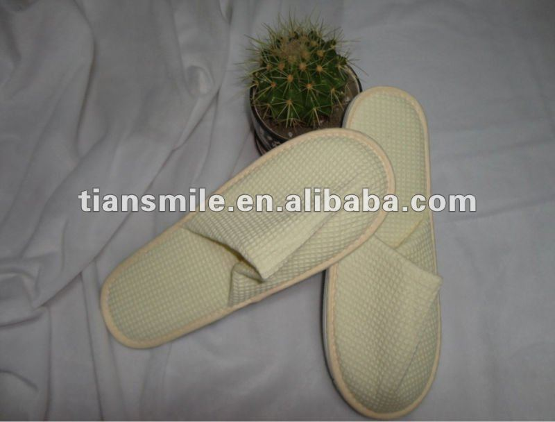 beige waffle disposable slipper for five stars hotel