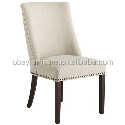 french style larger seat and scoop back with bronze nailhead trim upholstery linen dining chair