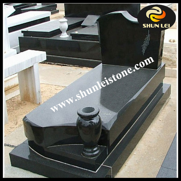 black granite headstones for graves with vase and lantern