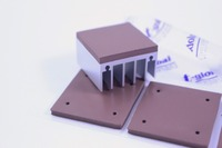 Low oil bleed cooling thermal conductive insulation gap pad