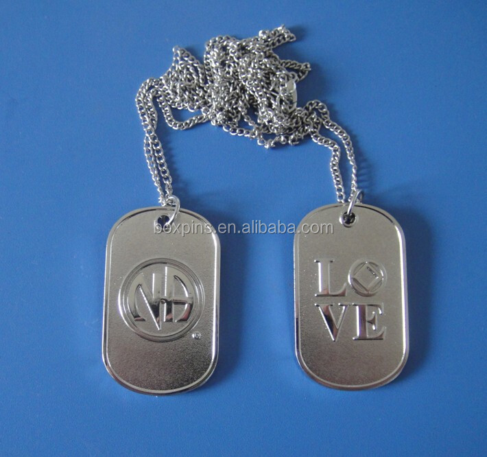 Matte and shiny silver embossed NA logo dog tag necklaces