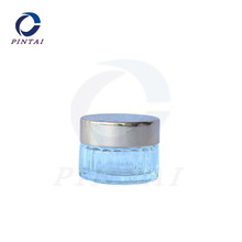 Empty glass cosmetic cream jar with alulinum lid