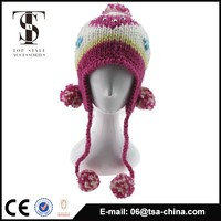 100% acrylic jacquard knitted beanie hat in winter with big pom pom