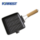 Square cast iron grill pan with wooden handle