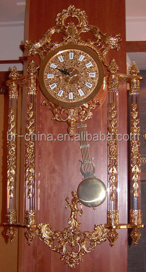 triangle and small crystal table clock in gold finishing