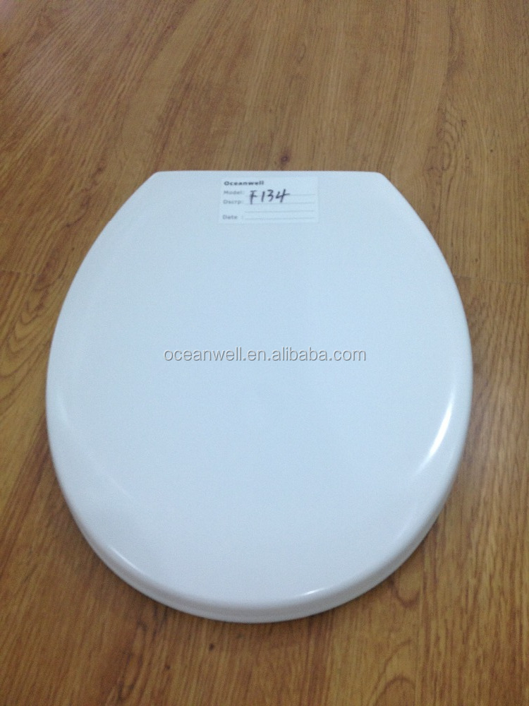 Quick release infection-resistant UF toilet seat cover