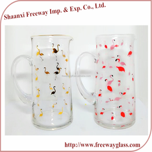 clear glass water pitcher with flamingo design