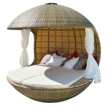 Tropical round cocoon shaped outdoor sunbed with rattan covered and canopy beach lounge