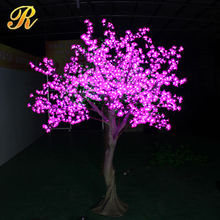 Artificial flowers light up cherry blossom trees
