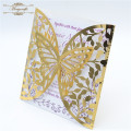 Luxurious butterfly laser cut wedding invitation card in gold