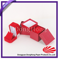 A set of red colored wedding favor small cardboard box