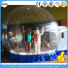 Christmas inflatable snow globe with snow flying for commercial advertising