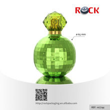 Innovative design 100ml China perfume bottle earth shape with green crystal cap