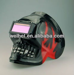 Auto darkening solar powered welding helmet skull