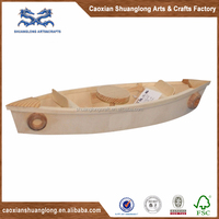 Small handmade wooden toy fishing boat