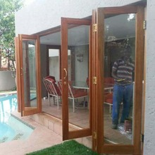 Good safety performance tempered glass inserts solid wood folding door