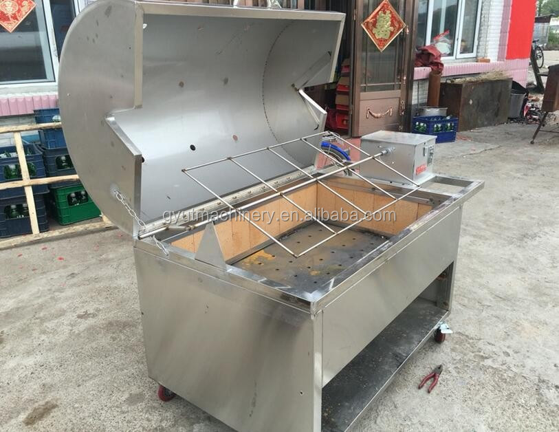 (wechat:008618236968979) Rotary charcoal grill roaster/ pig grill/ Rotary sucking pig roaster machine