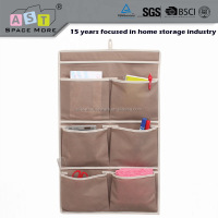 Hanging brown wall mesh pocket storage organizer