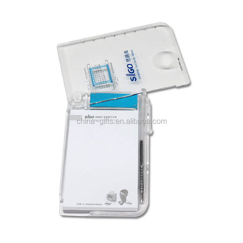 Slide open plastic box with memo pad and pen