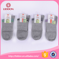 Casual style plain color simple patterned wellness combed cotton custom sports men cheap bulk wholesale socks