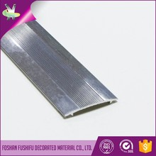 Decorative and protective aluminum carpet tile trims